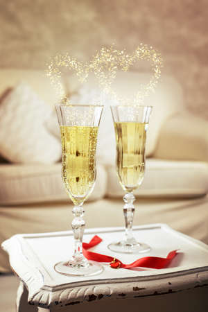 champagne flutes: Two glasses of champagne for a celebration