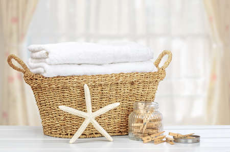Basket of laundry with pegs Stockfoto