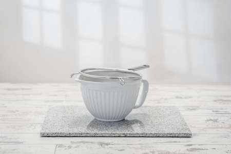 worktop: Mixing bowl in the kitchen with metal sieve