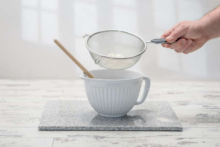worktop: Baking bowl with sifted flour in the kitchen Stock Photo