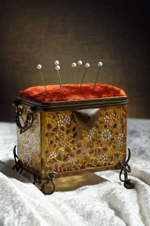 casket: Antique sewing casket with pins in cushion