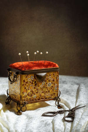 sewing box: Antique sewing box with scissors and fabric
