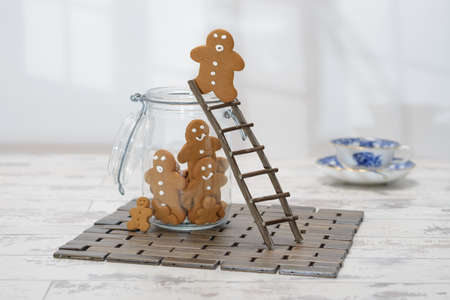 gingerbread: Gingerbread man at the top of a ladder about to jump into cookie jar
