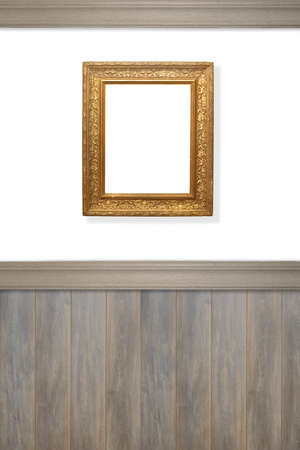 wood panelled: Antique ornate gilt frame on wall left blank for advertising