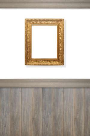 wood panelled: Antique ornate gilt frame on wall left blank for advertising