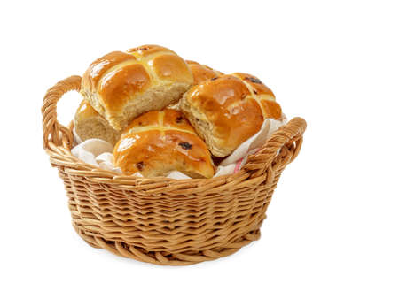 Basket of Hot Cross Buns on a white background for Easter