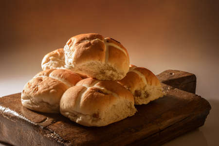 Stack of hot cross buns for Easter with ceative lighting