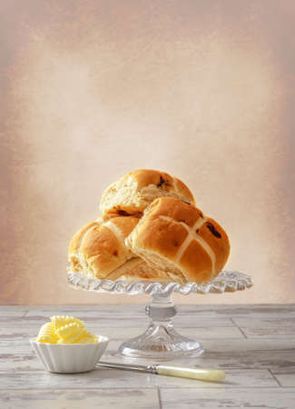 Hot cross buns with serving of butter