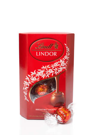 lindt: TELFORD, UK - MARCH 25, 2014: Photo of a box of Lindt Lindor chocolate truffles.  Lindt is part of the Lindt & Sprungli group, a Swiss company.  Since 1845 Lindt has been dedicated to producing the worlds finest chocolates. Editorial