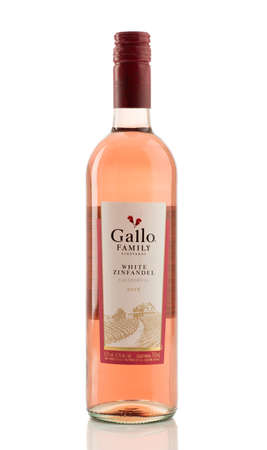 white zinfandel: TELFORD, UK - FEBRUARY 21, 2014: Photo of a Gallo Family bottle of White Zinfandel wine.  E & J Gallo winery is currently the largest winery in the world being family owned and established in 1933