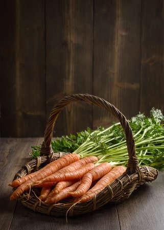 dug: Basket of freshly dug dirty carrots