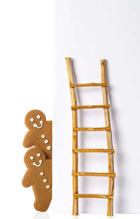 advertising board: Gingerbread men against advertising board with ladder
