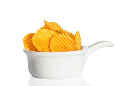 crinkle: Crinkle cut crisps on a white background Stock Photo