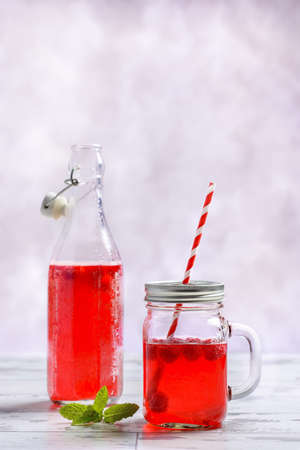cordial: Raspberry fruit drink with straw