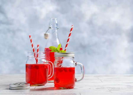 cordial: Summer raspberry fruit drinks with straws