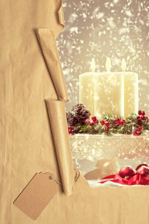 revealing: Torn paper parcel revealing Christmas candles Stock Photo