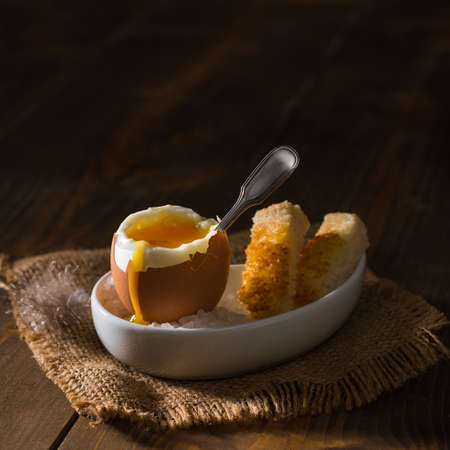 creatively: Creatively lit soft boiled egg with toast
