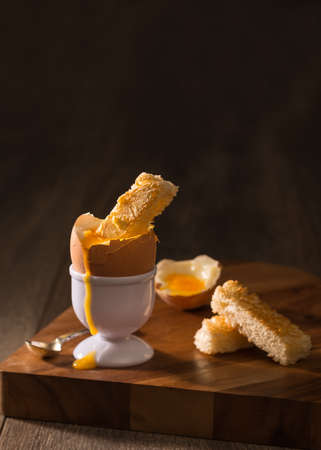 creatively: Toast dipped into a soft boiled egg - creatively lit