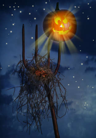 prongs: Pumpkin sitting on a pitchfork loaded with hay