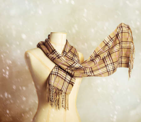 checkered scarf: Vintage tailors dummy with woollen winter scarf - blur in scarf to give motion effect Stock Photo