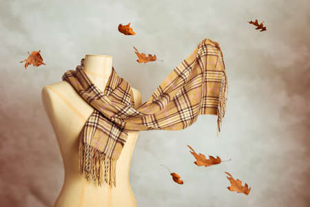 woollen: Vintage tailors dummy with woollen autumn scarf - blur in scarf to give motion effect