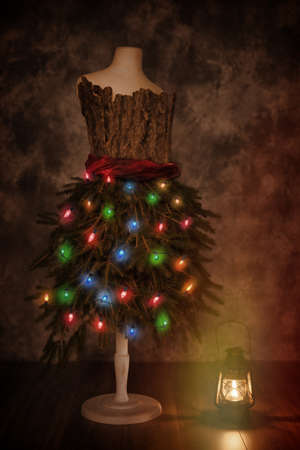 old fashioned christmas: Vintage mannequin dressed for Christmas with old fashioned lamp