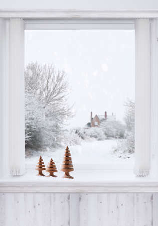 winter window: Winter window with turned wooden Christmas trees sitting on the ledge