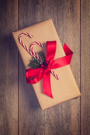 christmas gift: Christmas gift box with candy cane decoration