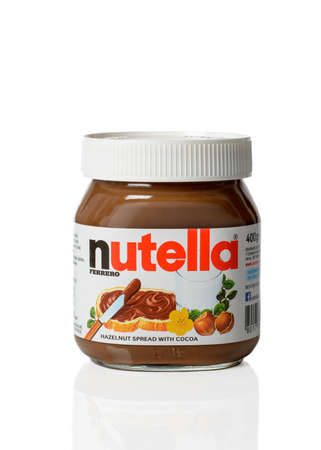 ferrero: TELFORD, UK - APRIL 01, 2015: A jar of Nutella hazelnut chocolate spread on white background.  Nutella is manufactured by the Italian Ferrero company based in Piedmont, Italy. Editorial