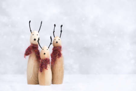 scarves: Reindeer animal figures with knitted scarves