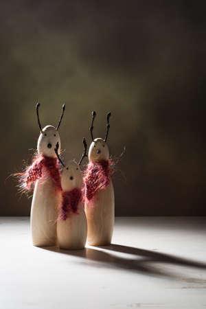 creatively: Creatively lit wooden reindeer animal figures with dark shadows