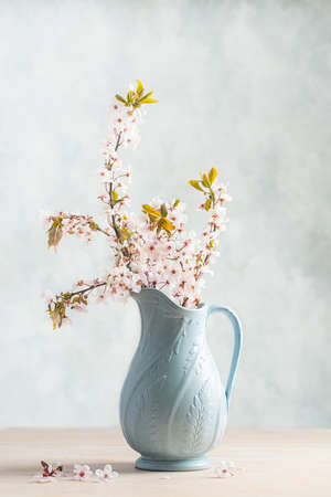 antique vase: Spring cherry blossom in antique vase