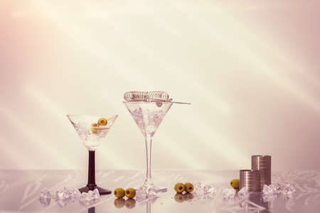 cocktail strainer: Mixing Martini cocktails over ice  in Art Deco glasses with olives