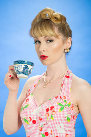 Vintage pin up girl with teacup