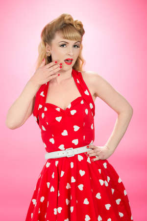 halterneck: Pin up girl wearing vintage 1950s dress Stock Photo