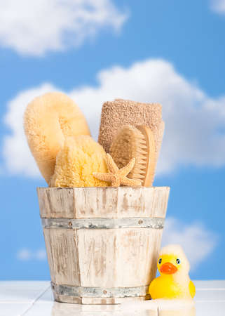 soap suds: Bucket filled with bathroom objects with rubber duck covered in soap suds
