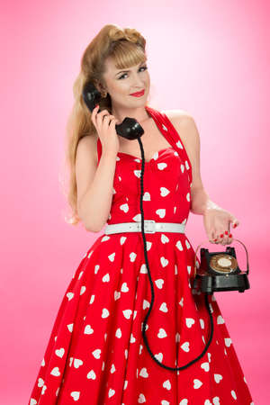 halterneck: Pin up girl with vintage telephone