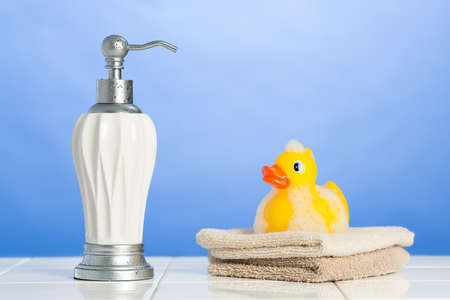 antibacterial soap: Soap dispenser with face cloths and rubber duck