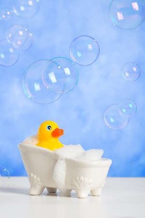 bathtime: Bathtime fun with rubber duck in bath tub with floating bubbles