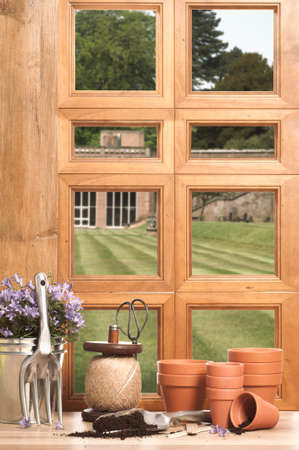 planters: The potting shed with window overlooking garden