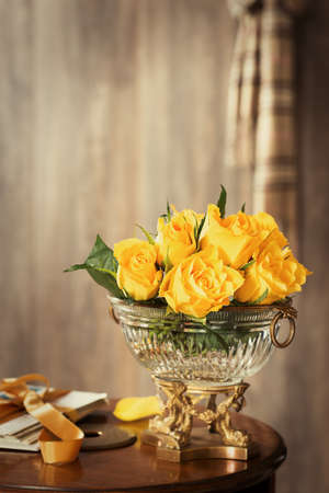 antique vase: Old fashioned garden roses in antique vase - plent of copy space Stock Photo