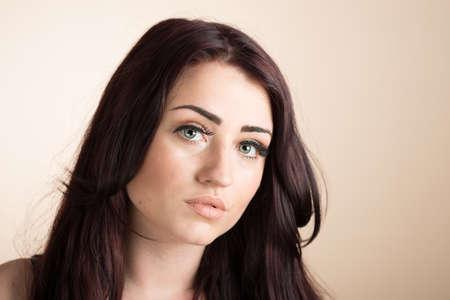 ojos marrones: De cerca la cara de una mujer hermosa joven Foto de archivo