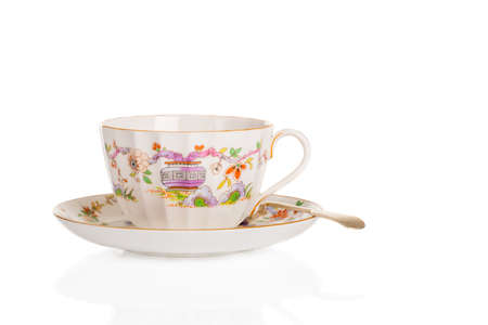 fluted: Antique fluted teacup and saucer with spoon on a white background