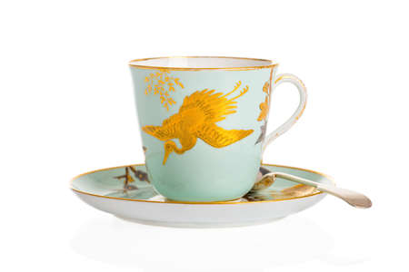 cup: Antique cup, saucer and spoon on a white background