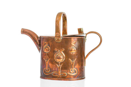 implementing: Antique Art Nouveau watering can isolated on a white background