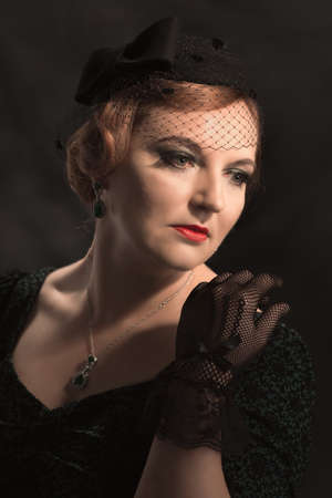 lace gloves: Glamorous twenties style portait of woman wearing black lace gloves and pillar box hat