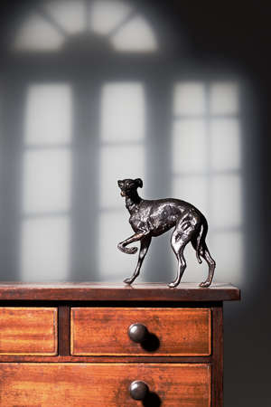 lurcher: Greyhound dog figure on antique dresser