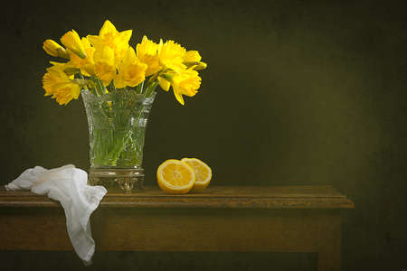 Rustic still life with antique vase filled with daffodils