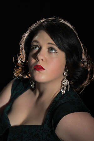Glamorous portrait of a woman wearing diamond earrings Stock Photo