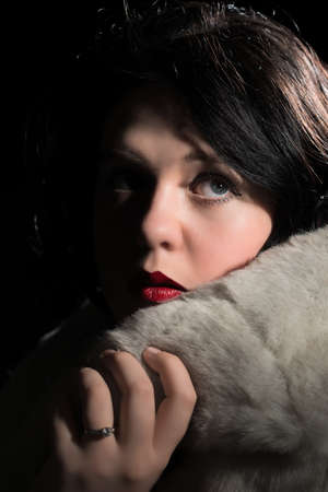 Portrait of a glamorous young woman wearing a fur coat Stock Photo